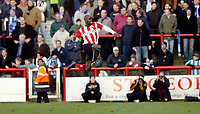 Photo: Leigh Quinnell.<br /> Brentford v Huddersfield Town. Coca Cola League 1. 21/01/2006. Brentfords lloyd Owusu jumps for joy after scoring a goal.