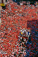 Overview of crowds celebrating the opening ceremony of the Fiesta of San Fermin, Pamplona, Spain