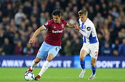 West Ham United's Fabian Balbuena (left) and Brighton & Hove Albion's Solly March battle for the ball during the Premier League match at the AMEX Stadium, Brighton.