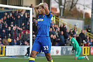 AFC Wimbledon striker Lyle Taylor (33) with head in hands after a miss during the EFL Sky Bet League 1 match between AFC Wimbledon and Peterborough United at the Cherry Red Records Stadium, Kingston, England on 12 November 2017. Photo by Matthew Redman.