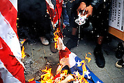 British Muslim activists burn the US flag outside the American embassy in London on 11 September 2010 to voice their anger at the plan by a US Christian pastor, Terry Jones,  to burn copies of the Koran on the same day. However, the US pastor has now postponed the event. © under license to London News Pictures.