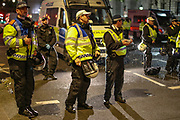 A police crew waiting for the protestors to search and video record before they are let go one-by-one in central London on Wednesday, June 3, 2020. (Photo/ Vudi Xhymshiti)