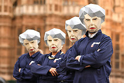 """Review of the Year 2017: November: Members of the GMB union dressed as """"Maybots"""" demonstrate outside the Palace of Westminster, London, where they made a last ditch plea to the Chancellor to give public sector workers a decent pay rise in the Budget."""