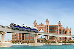 Monorail train approaching The Palm Atlantis luxury hotel on artificial Palm Jumeirah island in Dubai United Arab Emirates