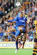 Cardiff city's Steven Caulker wins a header.  Barclays Premier league match, Hull city v Cardiff city at the KC Stadium in Hull on Sat 14th Sept 2013. pic by Andrew Orchard, Andrew Orchard sports photography,
