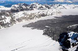 """A 4,000-foot-high mountainside released approximately 120 million metric tons of rock in 60 seconds during a landslide onto the Lamplugh Glacier in Glacier Bay National Park and Preserve. In an interview with the Anchorage Dispatch News, geophysicist Colin Stark of Columbia University's Lamont-Doherty Earth Observatory, described the slide as """"exceptionally large."""" He compared the massive landslide to roughly 60 million medium SUVs tumbling down a mountainside.<br /> <br /> The slide occurred on the morning of June 28  in a remote area of Glacier Bay National Park in southeast Alaska. It was first observed by Paul Swanstrom, pilot and owner of Haines-based Mountain Flying Service. Swanstrom noticed a huge cloud of dust over the Lamplugh Glacier during a flightseeing tour of Glacier Bay National Park several hours after the slide occurred. Swanstrom estimates the debris field to be 6.5 miles long, and one to two miles in width.<br /> <br /> This aerial photo of the Lamplugh Glacier landslide was taken two days after the landslide."""