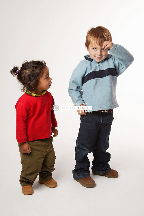 Young boys standing in a studio,