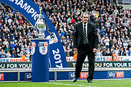 Ex-Newcastle United player Bobby Moncur places the EFL Sky Bet Championship trophy on the podium following the EFL Sky Bet Championship match between Newcastle United and Barnsley at St. James's Park, Newcastle, England on 7 May 2017. Photo by Craig Doyle.