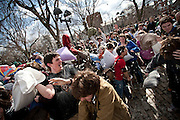 Participants in Boston's 4th annual citywide pillow fight,  battle each other on Cambridge Common yesterday.