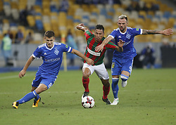 August 24, 2017 - Ibson Pereira de Melo  (C) of Maritimo vies for the ball with   Volodymyr Shepeliev   (L) and  Mykola Morozyuk  (R) of Dynamo  during the Europa League second play-off soccer match between FC Dynamo Kyiv and FC Maritimo, at the Olimpiyskyi stadium in Kyiv, Ukraine, August 24, 2017. (Credit Image: © Anatolii Stepanov via ZUMA Wire)