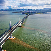The Hong Kong–Zhuhai–Macau Bridge (HZMB), officially the Hong Kong–Zhuhai–Macao Bridge, is a 55-kilometre (34 mi) bridge–tunnel system consisting of a series of three cable-stayed bridges, an undersea tunnel, and four artificial islands. It is both the longest sea crossing and the longest open-sea fixed link on earth.It was opened in October 2018.