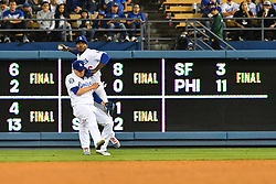 May 10, 2018 - Los Angeles, CA, U.S. - LOS ANGELES, CA - MAY 09: Los Angeles Dodgers right fielder Yasiel Puig (66) collides with Los Angeles Dodgers outfielder Enrique Hernandez (14) as he tries to make a throw during a MLB game between the Arizona Diamondbacks and the Los Angeles Dodgers on May 9, 2018 at Dodger Stadium in Los Angeles, CA. (Photo by Brian Rothmuller/Icon Sportswire) (Credit Image: © Brian Rothmuller/Icon SMI via ZUMA Press)