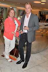 VISCOUNTESS GORMANSTON and her son HARRY GRENFELL at the launch of the 'Jasmine for Jaeger' fashion collection by Jasmine Guinness for fashion label Jaeger held at Fenwick's, Bond Street, London on 9th September 2015.