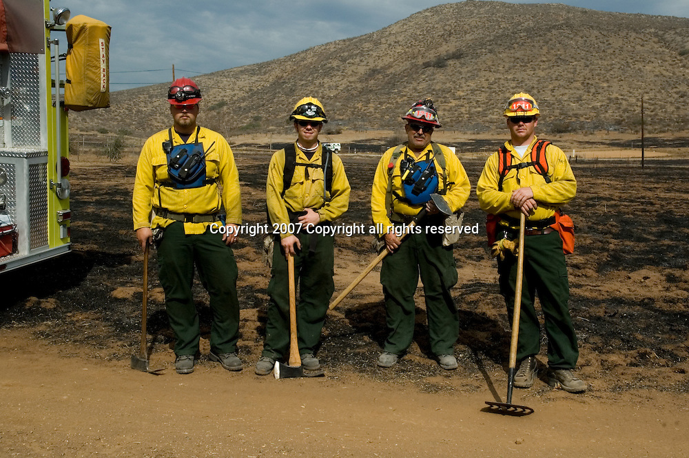 Firefighters on California mountainside. Wildfire's Destruction on the California landscapes.
