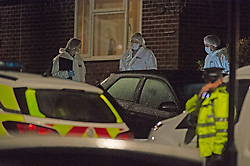 ©Licensed to London News Pictures 22/12/2019. <br /> Crawley Down ,UK. A large number of Police forensic officers at the murder scene tonight. Two people are dead and a third is fighting for life after a knife attack on a housing estate in Crawley Down, West Sussex Photo credit: Grant Falvey/LNP