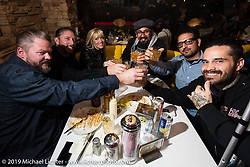 Yaniv Evan, Harpoon and friends in the cafe during the Mooneyes shop and Japan HQ party after the annual Mooneyes Hot Rod and Custom Show. Japan. Monday, December 8, 2014. Photograph ©2014 Michael Lichter.