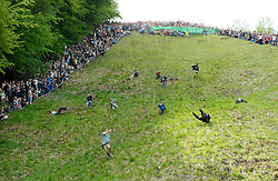 © Licensed to London News Pictures. 27/05/2013. Brockworth, Gloucestershire, UK.  The annual Cheese Rolling event.  Police had advised organisers including the local cheese supplier that they might be liable for any mishaps and the event this year was unofficial.  One man suffered a serious leg injury.  27 May 2013..Photo credit : Simon Chapman/LNP