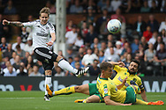 Fulham Midfielder Stefan Johansen (R) takes a shot at goal. EFL Skybet football league championship match, Fulham  v Norwich city at Craven Cottage in London on Saturday 5th August 2017.<br /> pic by Steffan Bowen, Andrew Orchard sports photography.