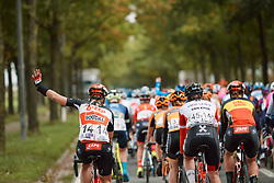 Calling for the team car at the 2020 Ronde van Vlaanderen - Elite Women, a 135.6 km road race starting and finishing in Oudenaarde, Belgium on October 18, 2020. Photo by Sean Robinson/velofocus.com