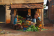 Four African women preparing produce for sale