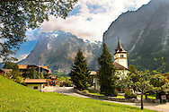 Church & old village of Grindelwald in summer, Bernese Alps, Switzerland .<br /> <br /> Visit our SWITZERLAND  & ALPS PHOTO COLLECTIONS for more  photos  to browse of  download or buy as prints https://funkystock.photoshelter.com/gallery-collection/Pictures-Images-of-Switzerland-Photos-of-Swiss-Alps-Landmark-Sites/C0000DPgRJMSrQ3U