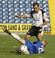 Photo. Aidan Ellis.Digitalsport<br /> Stockport County v Luton Town.<br /> Coca-Cola League Division 1.<br /> 18/09/2004.<br /> Stockport's Derek geary tackles luton's Ahmet Brkovic