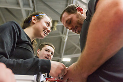 New Balance Indoor Grand Prix Track & FIeld:  Ryan Whiting shot putter signs autographs for fans trackside