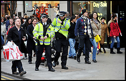 Police officers petrol in Oxford Street after an 18 year old  boy was stabbed to death Oxford Street, central London, on Boxing Day, during the Boxing Day Sales Tuesday December 27, 2011. Photo By Andrew Parsons/i-Images