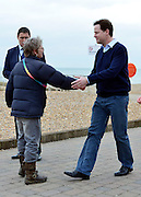 © Licensed to London News Pictures. 10/03/2013. Brighton, UK.Nick Clegg meets a ember of the public.  Nick Clegg, Liberal Democrat Leader and Deputy Prime Minister walks along Brighton seafront with his Deputy Chief of Staff, Jo Foster, before giving his keynote speech to the Liberal Democrat Spring Conference in Brighton today 10th March 2013. Photo credit : Stephen Simpson/LNP