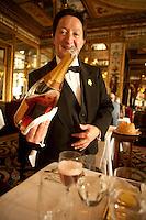 Sommelier Patrick Tamisier pouring Champagne at Le Grand Vefour, Paris - Photograph by Owen Franken
