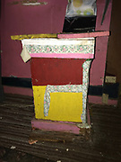 123.	table from inside grocery painted red, yellow green 2ft tall and 2ft end wide<br />