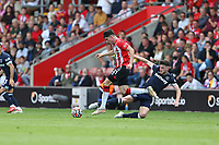 Football - 2021/ 2022 Premier League - Southampton vs. West Ham United - St Mary's Stadium - Saturday 11th August<br /> <br /> Declan Rice of West Ham United lunges in and fouls Southampton's Tino Livramento during the Premier League match at St Mary's Stadium Southampton <br /> <br /> COLORSPORT/Shaun Boggust