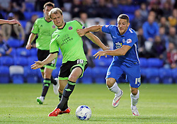 Conor Washington of Peterborough United in action with James McEveley of Sheffield United - Mandatory byline: Joe Dent/JMP - 07966386802 - 18/08/2015 - FOOTBALL - ABAX Stadium -Peterborough,England - Peterborough United v Sheffield United - Sky Bet League One
