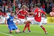 Leyton Orient's Michael Symes (l) is stopped by Swindon's Aden Flint © and Joe Devera (5). NPower league one, Swindon Town v Leyton Orient at the County Ground in Swindon on Saturday 8th Sept 2012.  pic by  Andrew Orchard, Andrew Orchard sports photography,