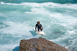 May 2, 2017 - Laguna Beach, CA, USA - A surfer jumps into the ocean at Laguna Beach on Tuesday, May 2, 2017. (Photo by Kyusung Gong/Orange County Register/SCNG) (Credit Image: © Kyusung Gong/The Orange County Register via ZUMA Wire)