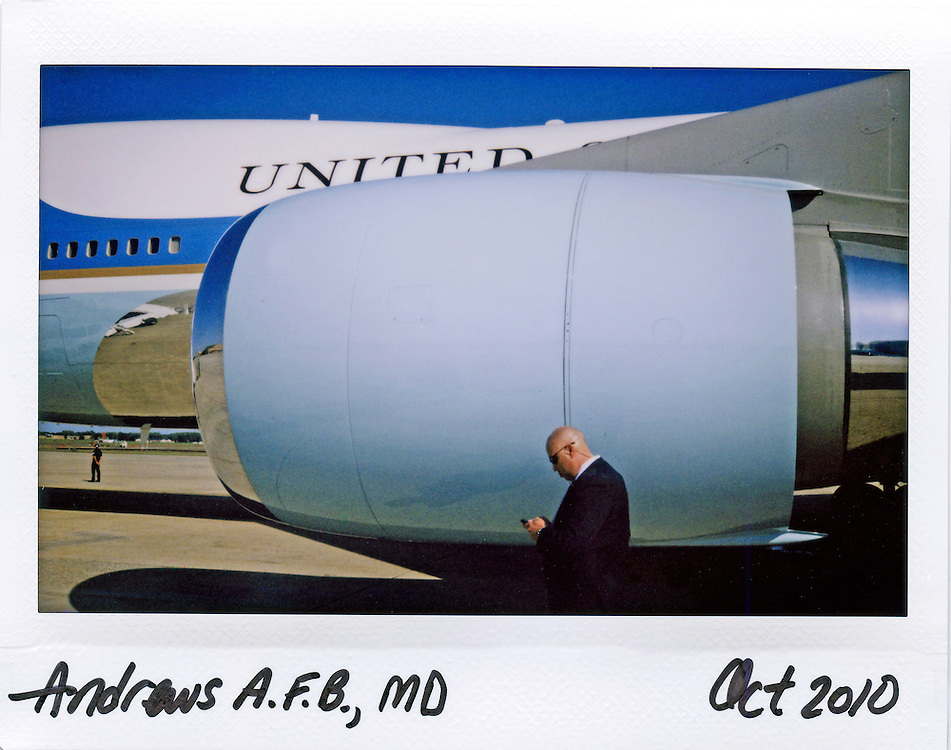 A U.S. Secret Service agent checks his blackberry beside Air Force One before the arrival of U.S. President Barack Obama at Andrews Air Force Base near Washington, October 10, 2010.