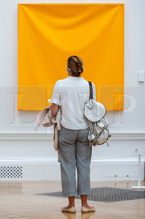 © Licensed to London News Pictures. 15/09/2021. LONDON, UK. 'LOOP (YELLOW)' by Angela de la Cruz, price £48,000. Preview of the Summer Exhibition 2021 at the Royal Academy of Arts in Piccadilly. Co-ordinated by Yinka Shonibare RA, the exhibition explores the theme of 'Reclaiming Magic' to celebrate the joy of creating art with around 1400 works by emerging and established artists featured in the exhibition.  The Summer Exhibition is the world's largest open submission contemporary art show and has taken place every year without interruption since 1769.  Photo credit: Stephen Chung/LNP