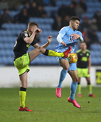 Coventry City's Maxime Biamou (right) and Cambridge United's Harry Darling battle for the ball