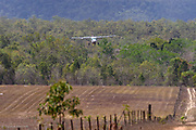 The mail plane comes in for a landing on the airstrip at Archer River.