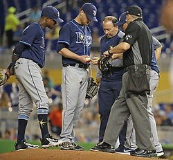 May 2, 2017 - Miami, FL, USA - Tampa Bay Rays pitcher Alex Cobb has his finger checked in the first inning against the Miami Marlins at Marlins Park in Miami on Tuesday, May 2, 2017. (Credit Image: © Al Diaz/TNS via ZUMA Wire)