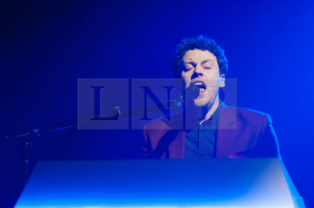 © Licensed to London News Pictures. 28/03/2014. London, UK.   Metronomy performing live at Brixton Academy to promote their latest album Love Letters. In this picture - Joseph Mount.  Metronomy are an english electronic music group consisting of members Joseph Mount (vocals, Guitar, keyboard),<br /> Oscar Cash (keyboards/sax), Anna Prior (bass), Olugbenga Adelekan (drums).   Photo credit : Richard Isaac/LNP