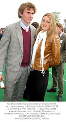 MR SAMI ROBERTSON and LADY GEORGINA PEPYS, at a race meeting in Surrey on 25th April 2003.PJD 12