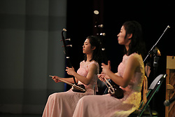 June 22, 2017 - Shenyan, Shenyan, China - Shenyang, CHINA-June 22 2017: (EDITORIAL USE ONLY. CHINA OUT) ..The 18-year-old orphan twins Zhao Chunqing and Zhao Chunmeng hold a concert of traditional Chinese musical instrument erhu in Shenyang, northeast China's Liaoning Province, June 22nd, 2017. They expressed thankness to their teacher at the end of the concert. (Credit Image: © SIPA Asia via ZUMA Wire)