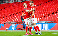 LONDON, ENGLAND - MARCH 31: Jakub Moder and Maciej Rybus of Poland celebrates scoring the goal with during the FIFA World Cup 2022 Qatar qualifying match between England and Poland on March 31, 2021 in London, United Kingdom. Sporting stadiums around the UK remain under strict restrictions due to the Coronavirus Pandemic as Government social distancing laws prohibit fans inside venues resulting in games being played behind closed doors. (Photo by Wlosek/PressFocus/MB Media)