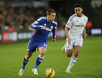 Chelsea's Eden Hazard vies for possession with Swansea City's Neil Taylor<br /> <br /> Photographer /Ashley CrowdenCameraSport<br /> <br /> Football - Barclays Premiership - Swansea City v Chelsea - Saturday 17th January 2015 - Liberty Stadium - Swansea<br /> <br /> © CameraSport - 43 Linden Ave. Countesthorpe. Leicester. England. LE8 5PG - Tel: +44 (0) 116 277 4147 - admin@camerasport.com - www.camerasport.com