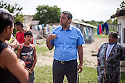 Cristian Buceanu (middle), a Roma council member, elected with the support of residents from Frumusani in 2012 discussing the longtime electricity issue with inhabitans of the Roma area in Frumusani.