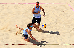 Cyprus' Georgios Chrysostomou (left) and Dimitris Apostolou in action during the Men Preliminary - Pool C Beach Volleyball match at Coolangatta Beachfront during day two of the 2018 Commonwealth Games in the Gold Coast, Australia.