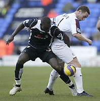 Photo: Aidan Ellis.<br /> Bolton Wanderers v Fulham. The Barclays Premiership. 11/02/2007.<br /> Bolton's Kevin Nolan (R) battles with Fulham's Papa Bouba Diop