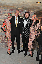 Waitresses and left to right,JEREMY KING and MARC JACQUES BURTON at the launch party for the new nightclub Tonteria, 7-12 Sloane Square, London on 25th October 2012.