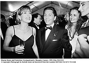 Sharon Stone and Valentino. Unzipped party. Mougins. Cannes. 1995. Film 95231f33<br />© Copyright Photograph by Dafydd Jones<br />66 Stockwell Park Rd. London SW9 0DA<br />Tel 0171 733 0108